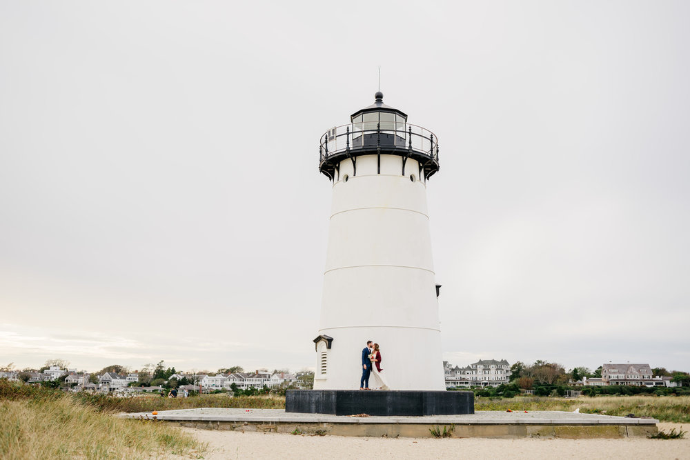 wedding bride and groom in front of the edgartown light house