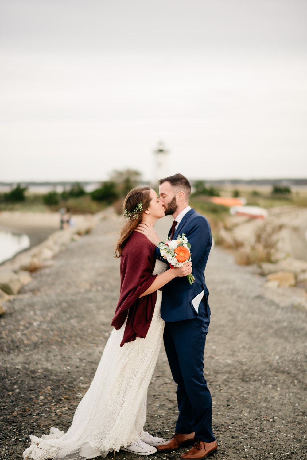 edgartown lighthouse elopement and wedding portraits of a couple kissing