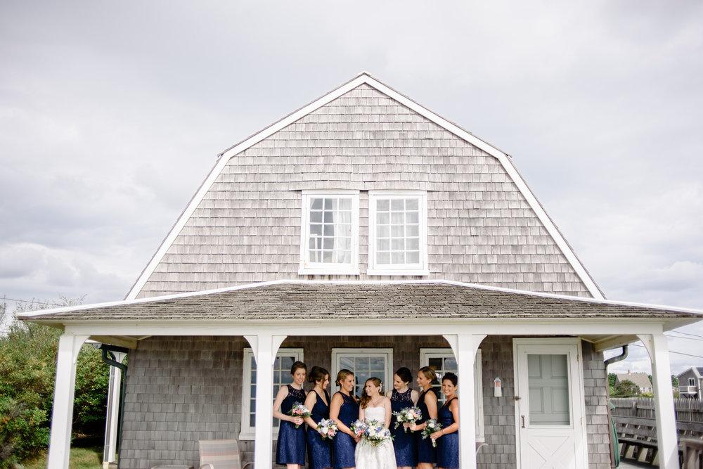 cape cod style house in truro with bridesmaids wearing blue
