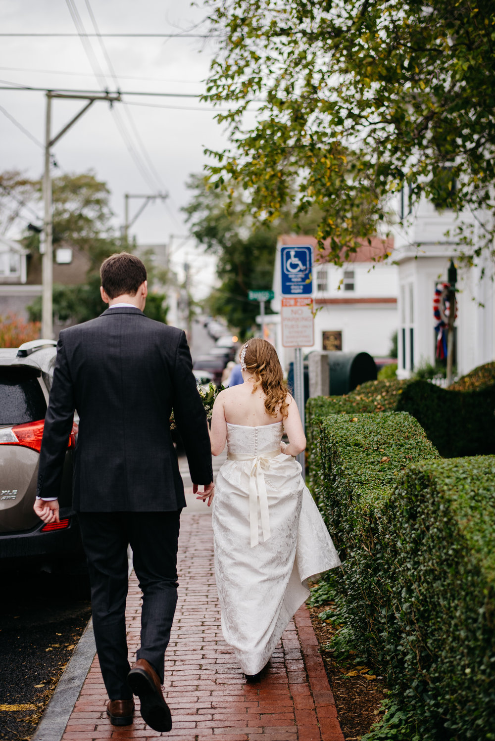 p-town wedding couple walking down the street