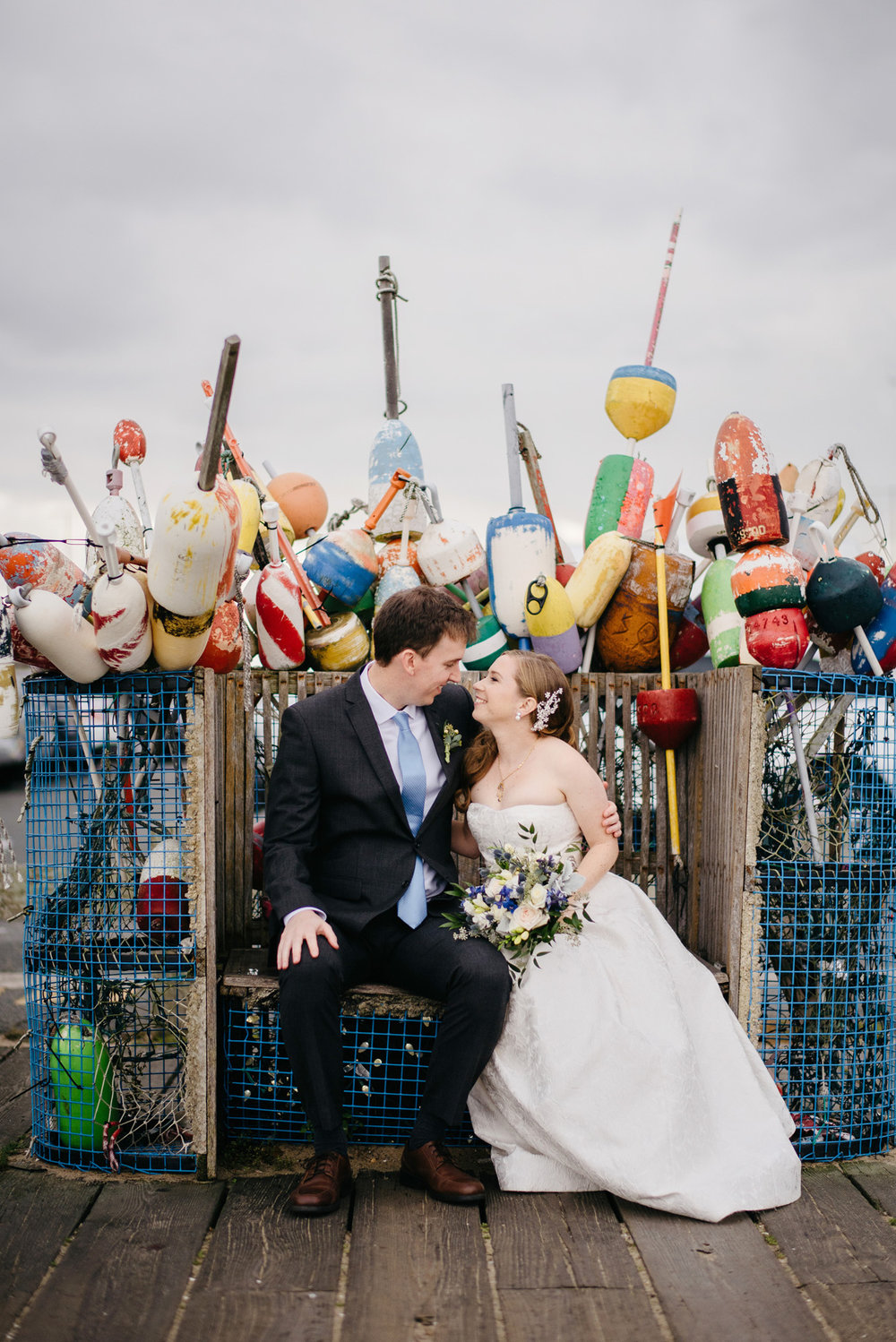 provincetown wedding portrait or bride and groom with buoys downtown