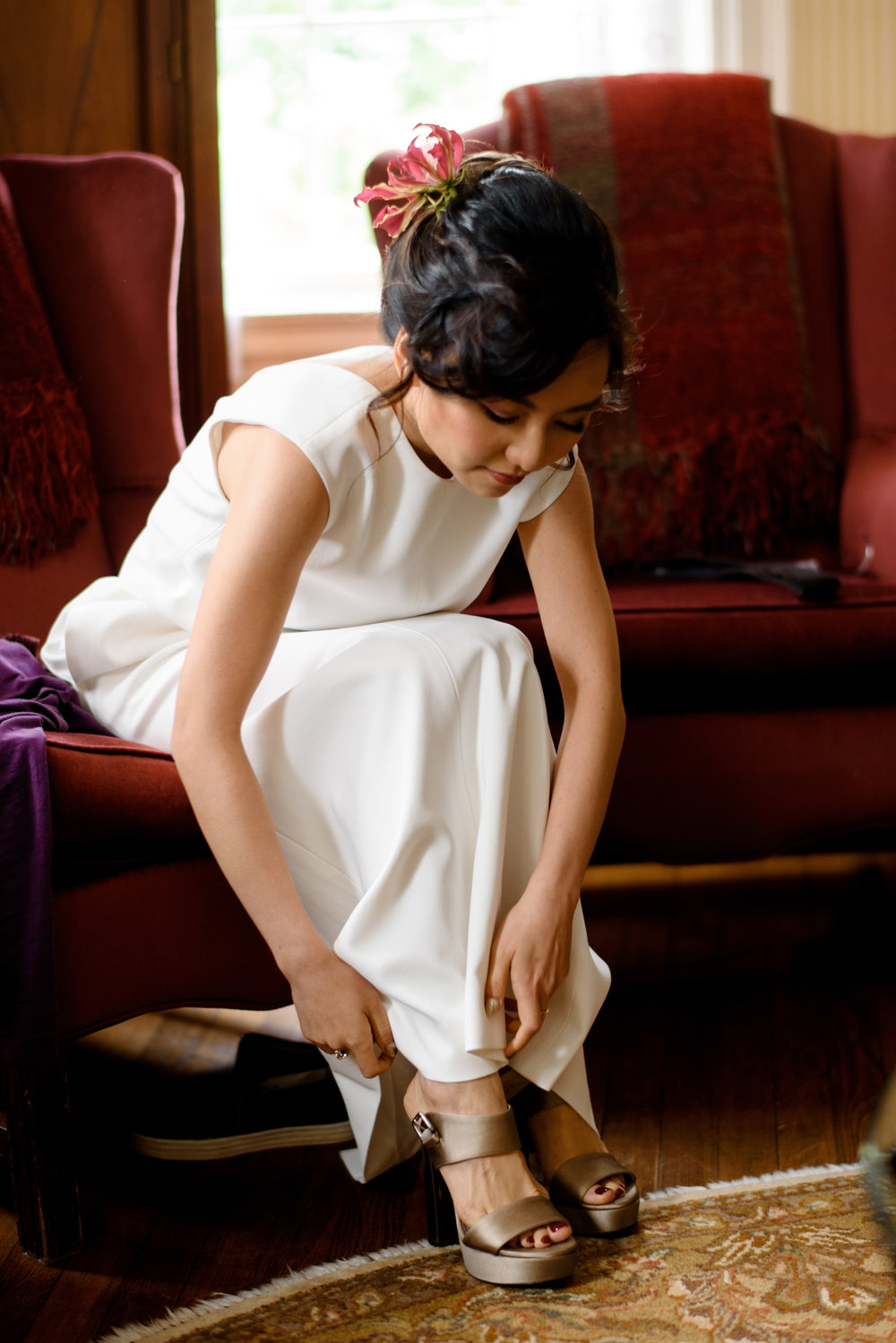 stylish asian bride getting ready at her wedding in new england
