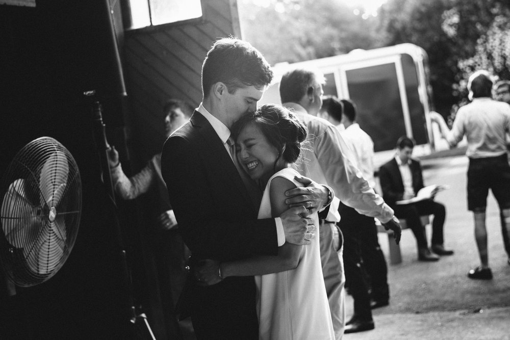 bride and groom hugging each other in a new hampshire barn