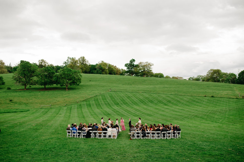 stunning cloudy outdoor ceremony at gibbet hill barn in groton , ma