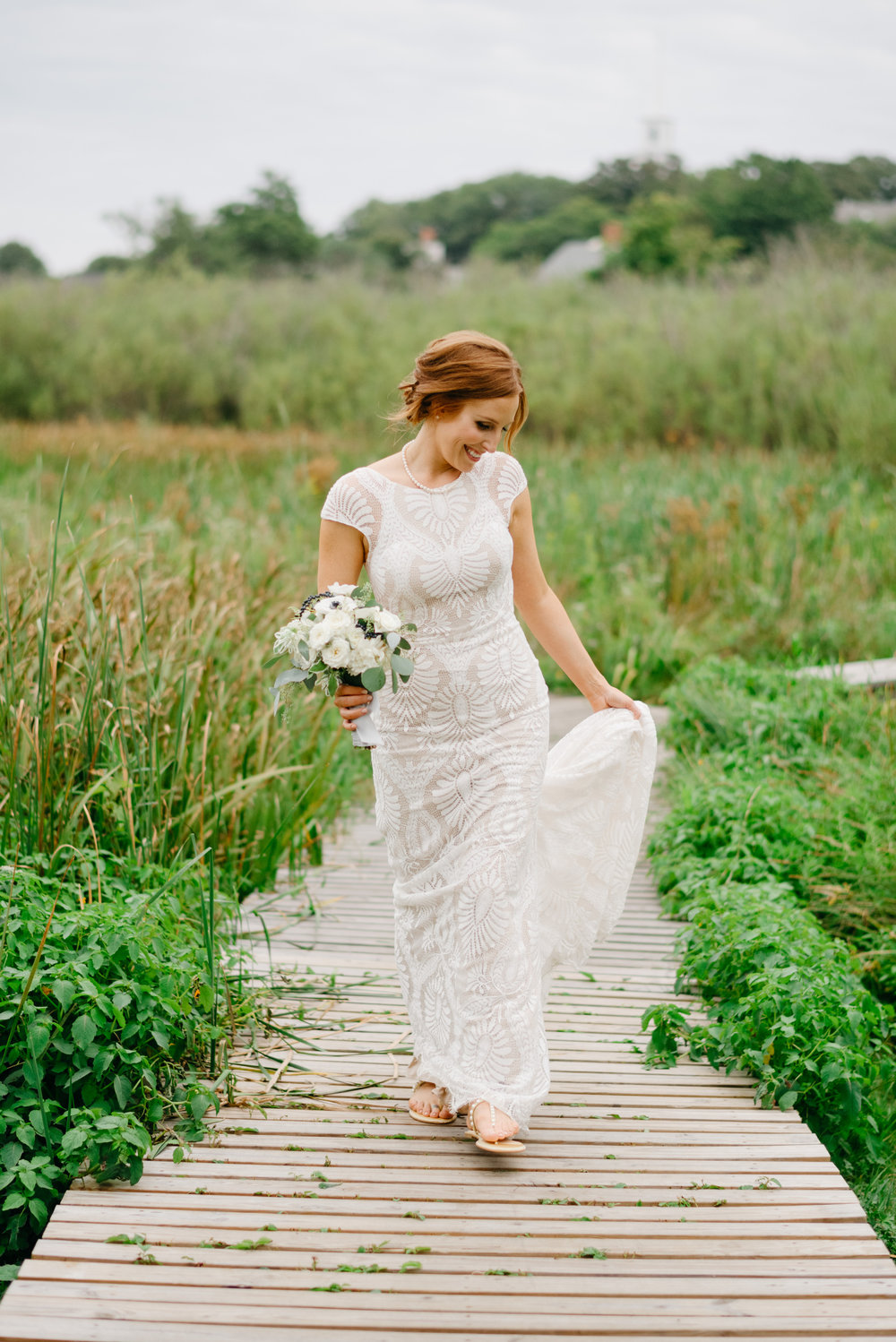 beautiful bride walking in field in nantucket isalnd