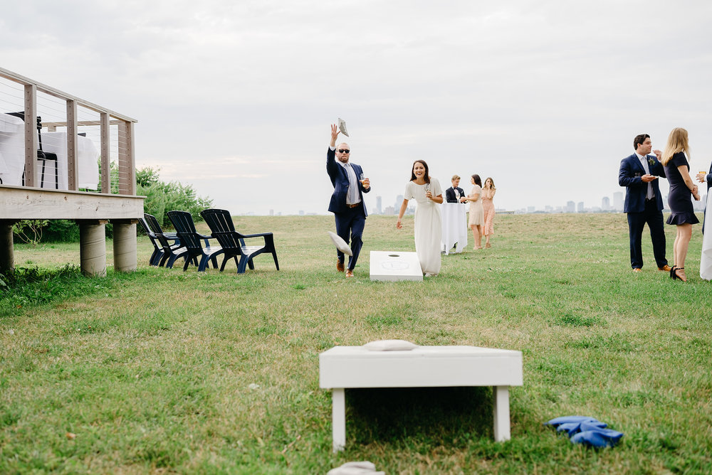 bride and groom playing corn hole boston destination weddings