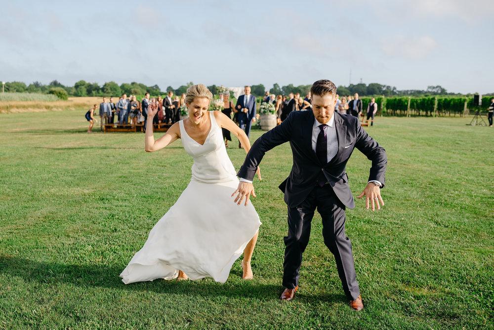 couple doing the post ceremony happy dance