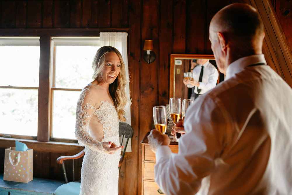 bride drinking with dad at her wedding on the cape