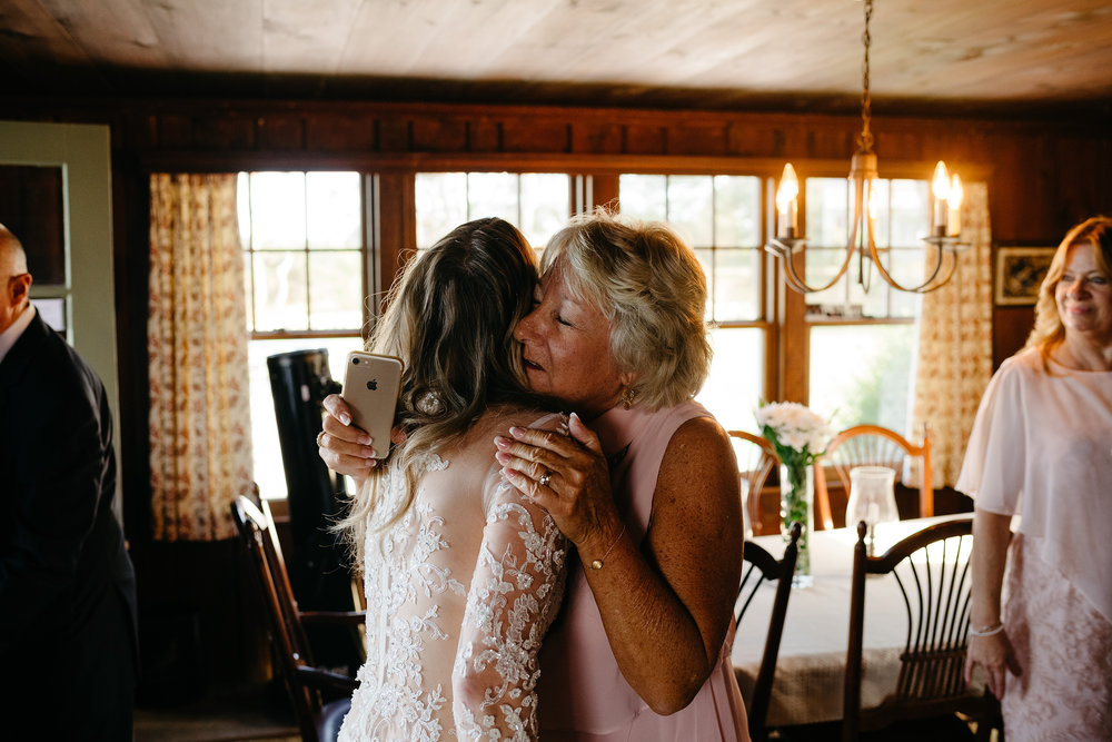 bride hugging her mom on the beach in cape cod