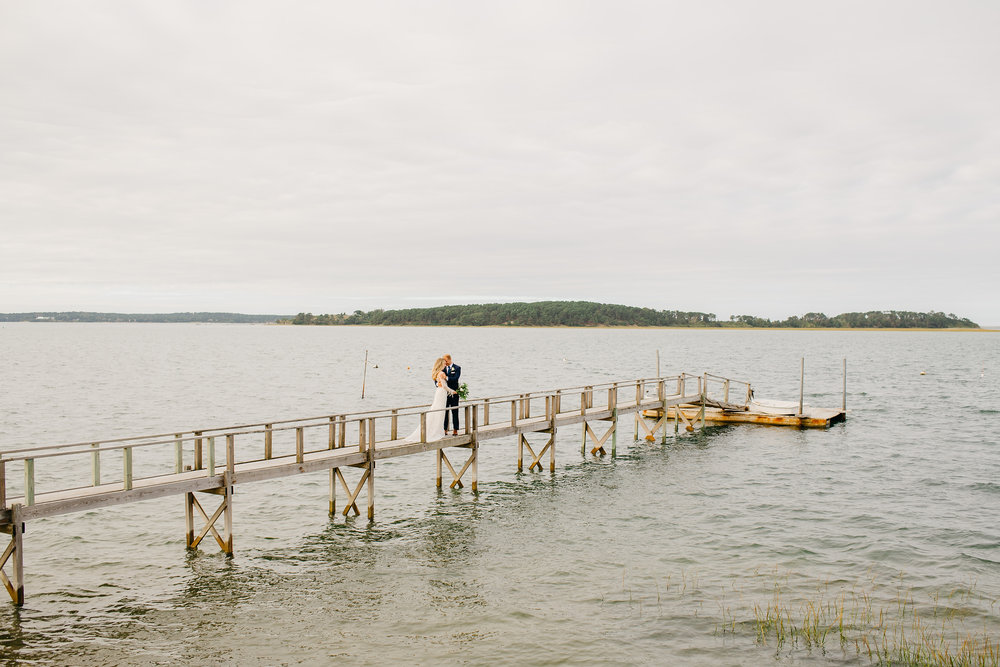 cape cod wedding portrait of bride and groom on dock