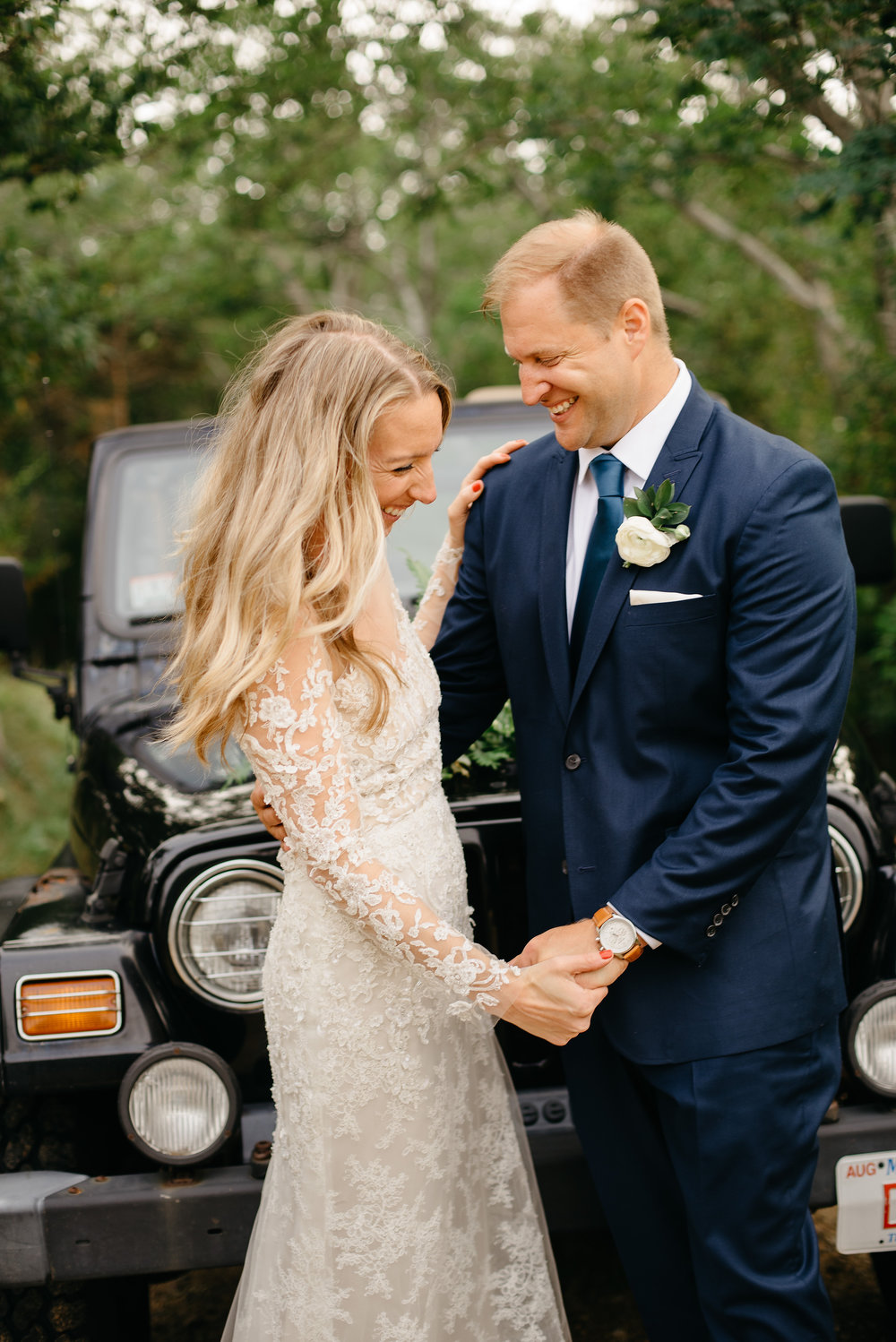 bride and groom with their jeep in cape cod