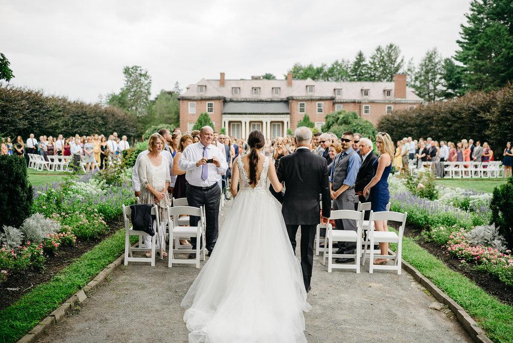 bride walking down the aisle in best outdoor venue in boston