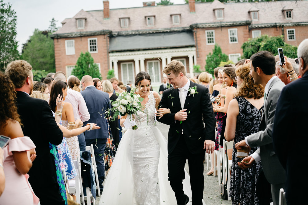 guests throwing flowers at elm bank recessional