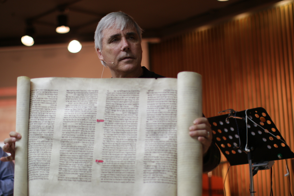 Dr. Carroll holds one of three existing scrolls of Isaiah that survived from the 18th century