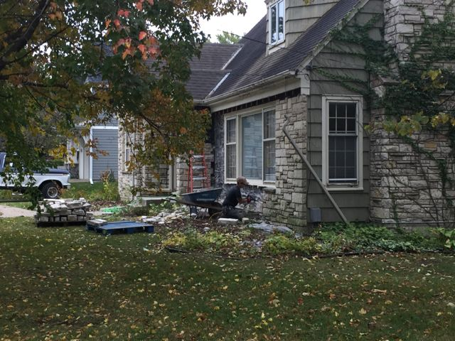 On October 8, workers began removing stone from the parsonage exterior. It will be cleaned and reused for the church's new kitchen addition.