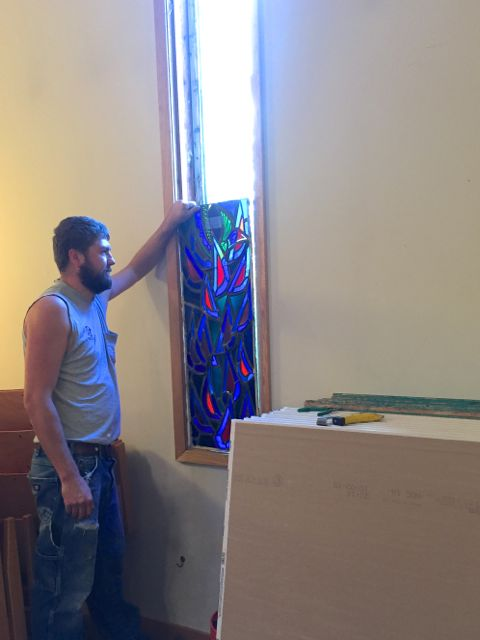 Today workers removed the stained glass window from the south wall of the Sanctuary, which will be torn down during construction. Artisans will repair the window while it awaits reinstallation in the new addition.