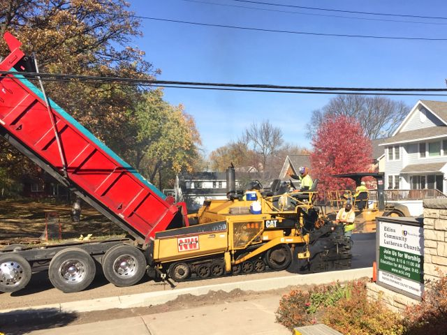 Although it's not part of our building project, the City of Edina's reconstruction of 54th Street will enhance our neighborhood. We were excited to get our first layer of pavement today after several weeks of driving on dirt.
