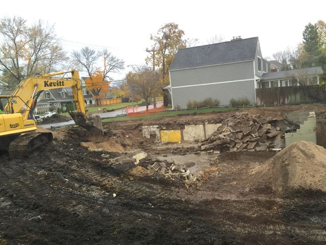 By October 29, removing the parsonage foundation was the only demolition work that remained.