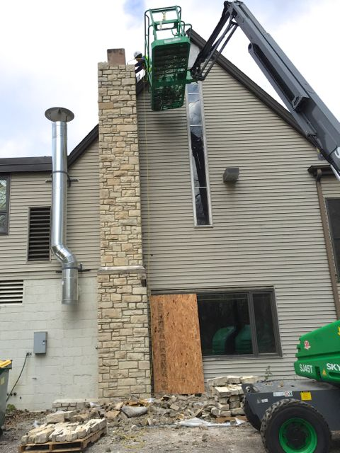 The clay liner in our chimney could not withstand the vibrations when crews tried to salvage stone from it earlier this month. Work was suspended while the boiler was connected to a temporary metal flue; stone removal has now resumed.