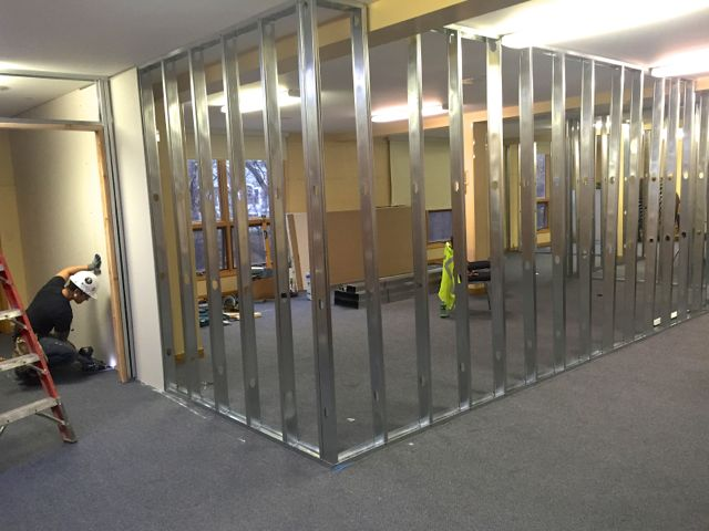 A temporary wall is being installed in the Fellowship Hall around the space where our new elevator and main staircase will be constructed.