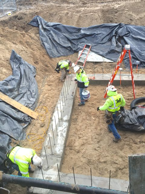 In between bouts of sleet and rain, workers managed to pour the footings for the kitchen addition.