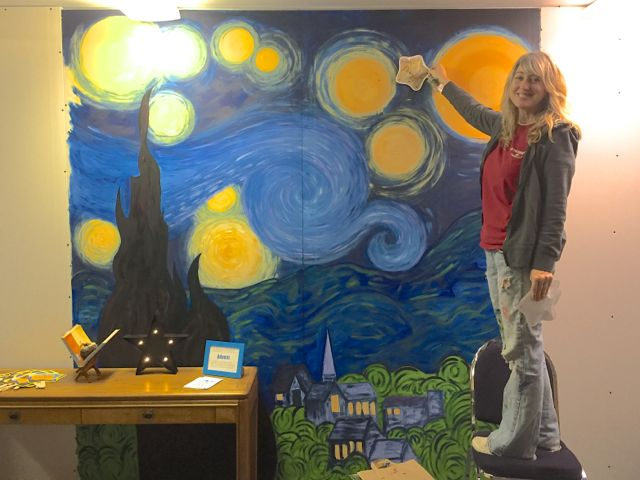 The church is full of temporary walls that block off construction zones. Kelly Rowley, Director of Children & Family Ministries, decided to put one section to good use. She painted a backdrop for a hanging display of planets and stars made by the Sunday School children.