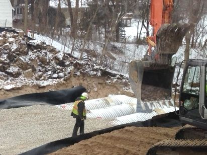 20160114a stormwater tanks adding gravel.jpg