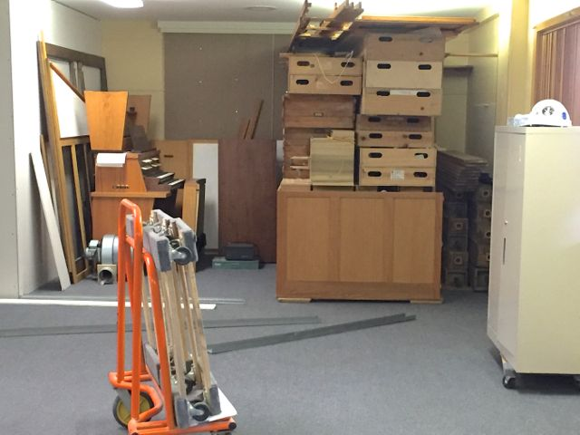 The phasing plan for the building project has changed such that significant remodeling of the existing structure will take place before the Sanctuary addition is complete. To accommodate the expanded construction zone, today the organ was moved from its storage space in the former Library to the southwest corner of the Social Hall.