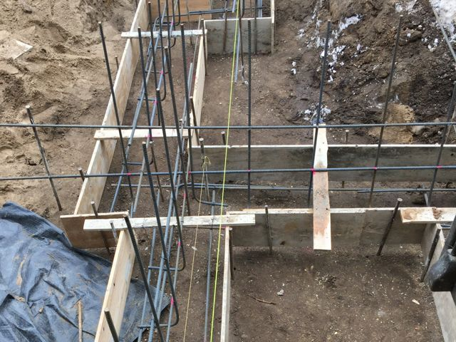 First, wooden forms were constructed, then a network of rebar was added that will reinforce the concrete.