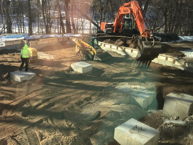 Dirt was dumped into the foundation area, smoothed out, then compacted in preparation for pouring the slab.