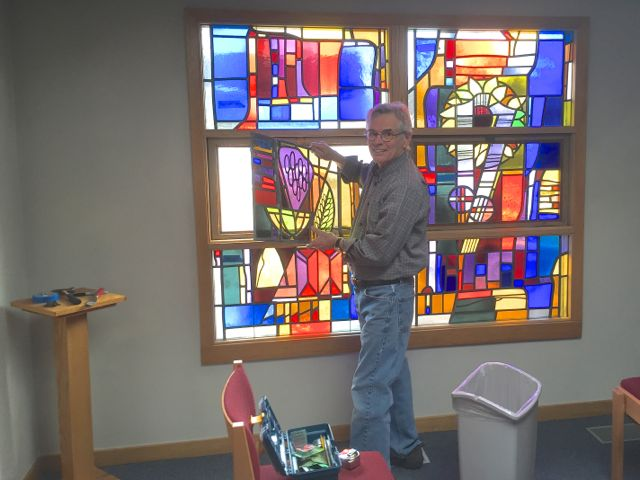 Dan Mason, an artist and member of ECLC's Construction Committee, carefully removes the stained glass windows from the northeast corner of the existing sanctuary. These walls will be removed in order to join the kitchen addition to the building. The windows will be stored until they can be installed in our new sanctuary.