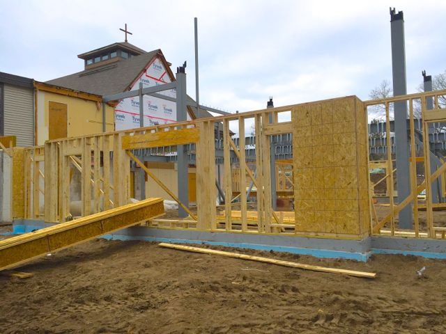 One by one, smaller sections of framing were lifted into place, secured to the foundation, and attached to each other.