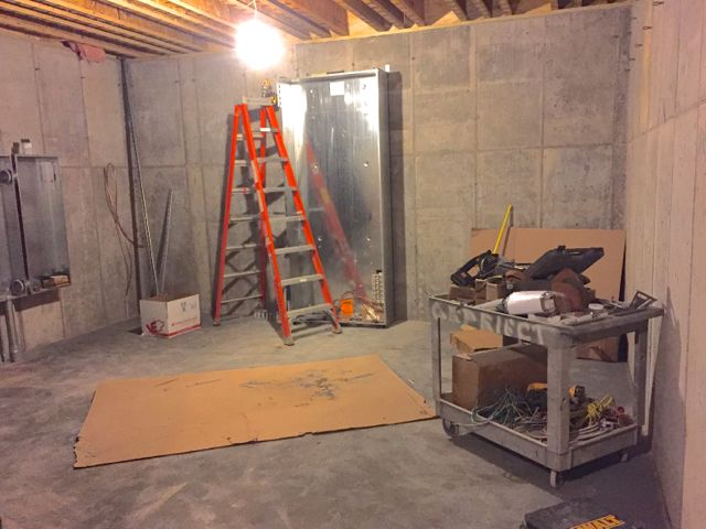 Earlier this week, the concrete slab was poured in the kitchen addition. After giving it time to cure, the installation of new electrical panels is now proceeding.