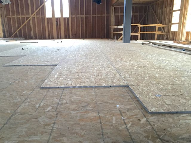 A extra layer of high-density fiberboard is being added to the sanctuary floor. It will provide a strong, stable surface for the eventual installation of hardwood flooring. It will also help buffer noise from travelling between the upper and lower levels of the south addition.