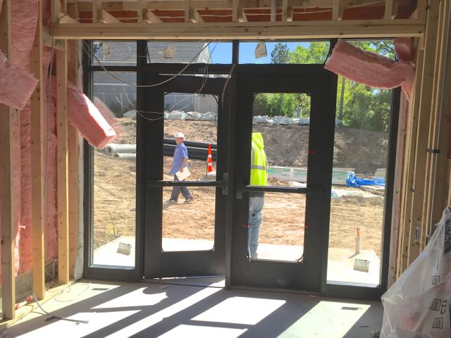 The exterior doors for the south addition entrances on the lower level have been installed, and the vestibule areas are being framed in and insulated. Interior sets of doors will be added in the near future.