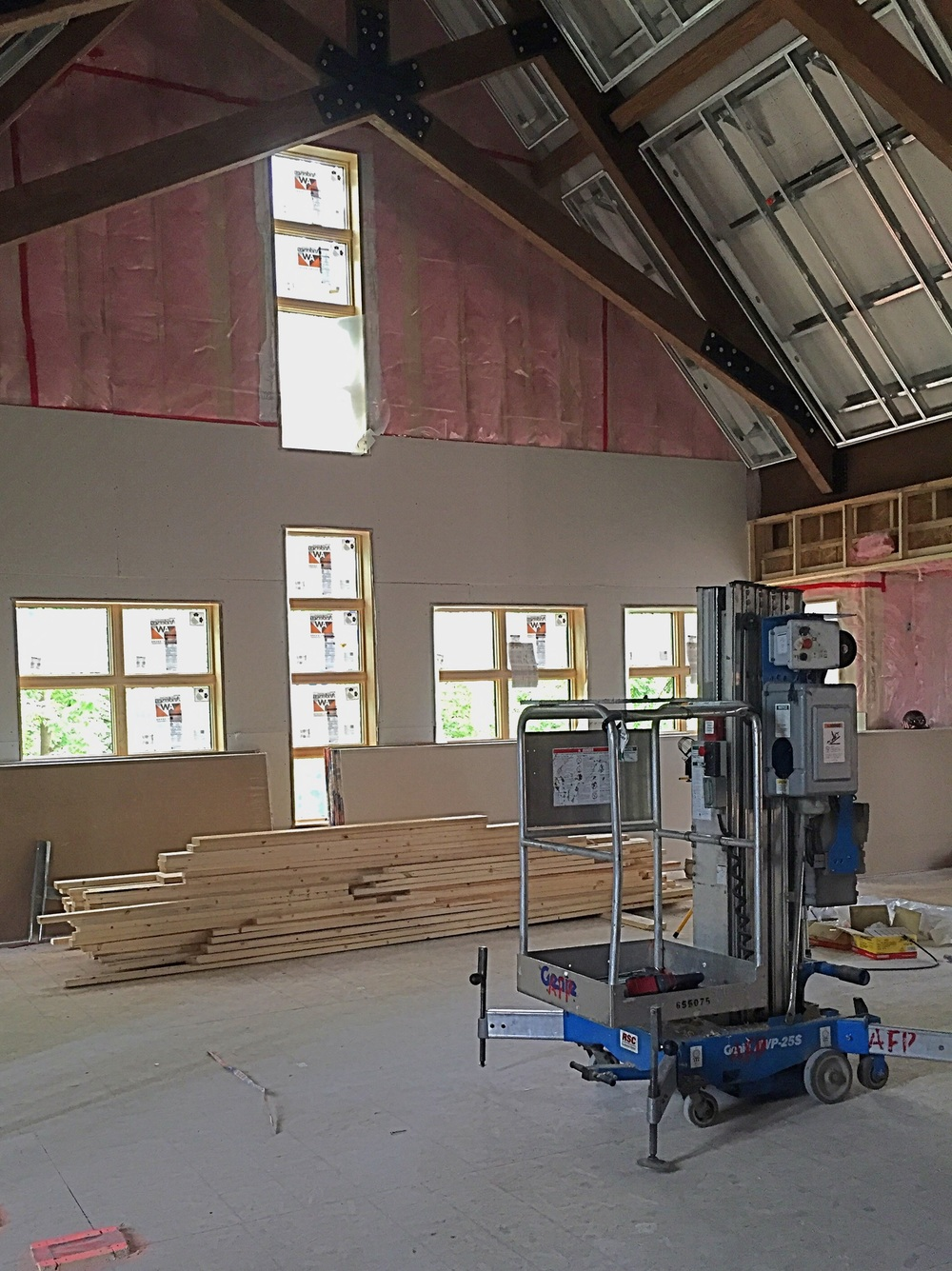After attaching insulation to the walls of the new sanctuary, crews are now working on hanging drywall.