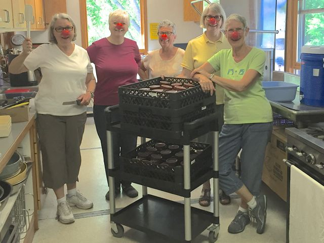 (Above, L-R) Karen, Ruth, Judy, Rynda, and Kay are packing up dishes and supplies in preparation for next week's decommissioning of the old kitchen, while simultaneously supporting Red Nose Day to help lift kids out of poverty.