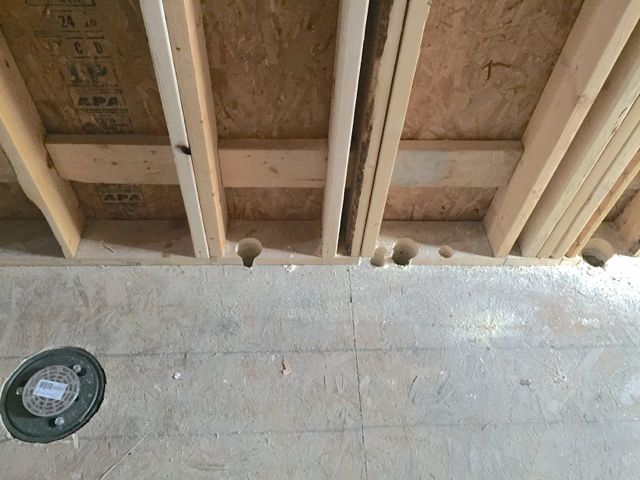 Ordinarily, finding new holes in a building would be alarming. Happily, the holes pictured above were made in preparation for running water and sewer lines to the new kitchen.