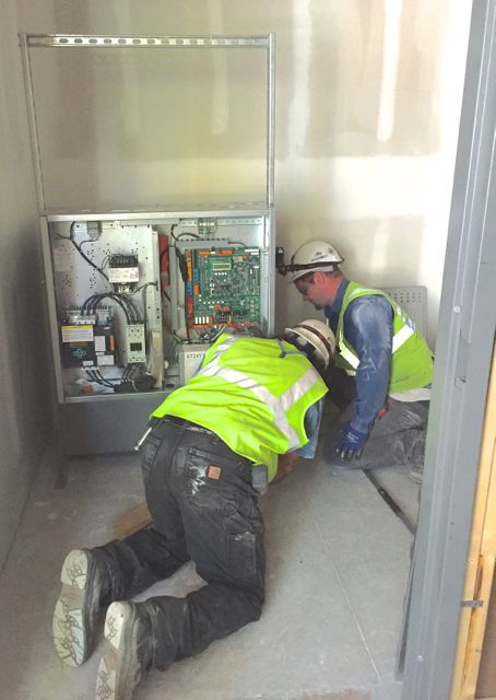 The elevator controller was installed in an adjacent mechanical room, which will also end up housing the hydraulic pump.  New additions to the elevator shaft include car guide rails and hydraulic cylinders.