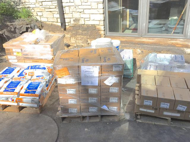 Today, pallets of mortar, grout, and tiles for the restrooms and kitchen were delivered.