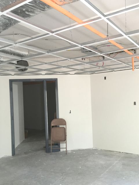 Suspended ceiling grids for acoustical tiles are being installed in all of the new classrooms.