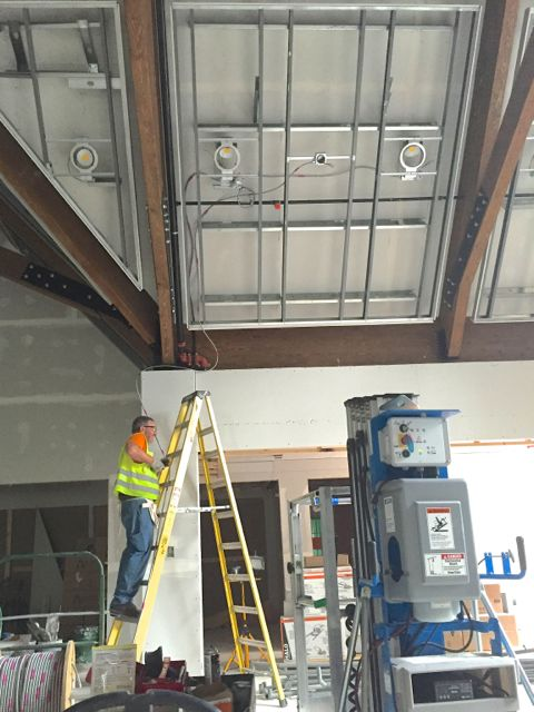 Crews are hanging sockets and running electrical wiring across the new sanctuary in preparation for the lighting system installation.