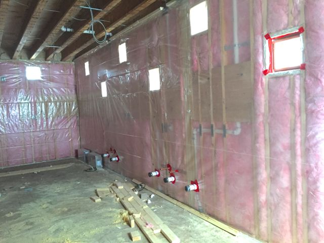 Mechanical rough-ins are complete and the insulation is finished. Next up for the walls in the new kitchen: sheetrock.