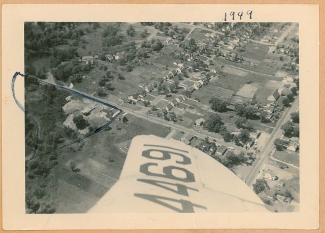 This aerial view of ECLC's property (outlined in black) from 1949 shows the original chapel under construction. Along the east (right) edge of the property is the old parsonage house, where ECLC began holding services and fellowship events in 1948.