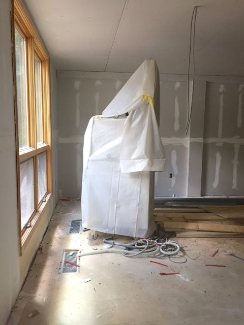 After the demolition of the old kitchen, the only appliance that remained was the dishwasher. Wrapped in protective sheeting, it shuttles from place to place avoiding active construction while (im)patiently waiting to get installed in the new kitchen.