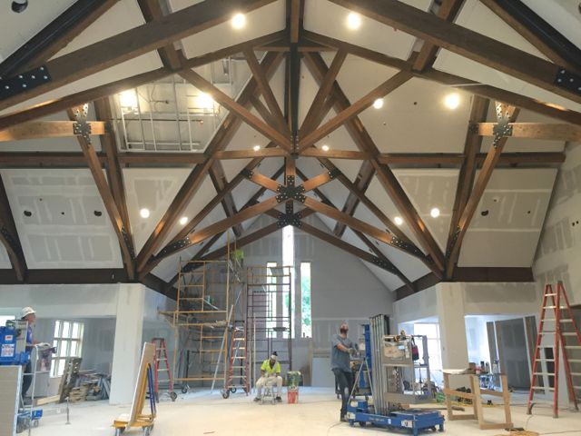 "Panels are getting attached to frames on the sanctuary ceiling. These ""clouds"" are designed to float above the surface to provide better acoustics in the space. Lights are also being installed and tested. Eventually, they will be connected to the lighting control system pictured below, which is housed in a utility room underneath the sanctuary."