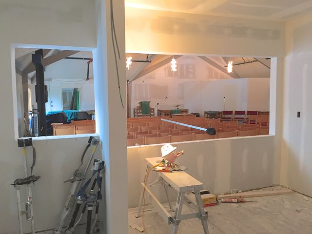 Openings have been cut in the south wall of the new kitchen, overlooking the space that will be transformed from a sanctuary into a fellowship hall. A serving counter will be installed on the right side, and the dish return area will go on the left.