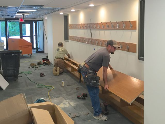 Today, carpenters installed coat hooks and built a bench with cubbies in the lower level hallway that's adjacent to several new classrooms.