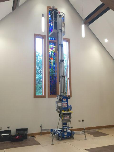 After being painstakingly re-leaded by artisans, our stained glass windows have returned home.