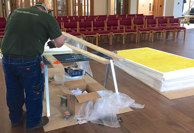 The final batch of acoustical panels is being added to the sanctuary this week. Workers are custom cutting each fiberglass sheet to fit perfectly around the lights in the low-ceiling corners of the room.